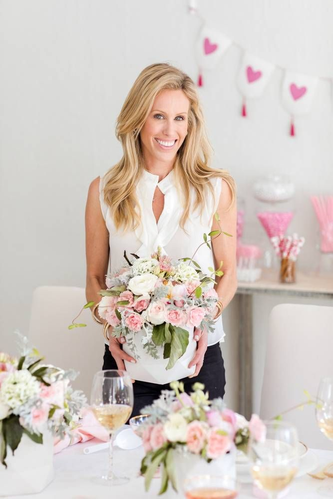 Learn how to throw the ultimate Galentine's Day party with entertaining and tablescape tips from Amanda Gluck of Fashionable Hostess. Discover the cutest place setting, desert and drink bar, and more. For more entertaining tips, visit domino.com.