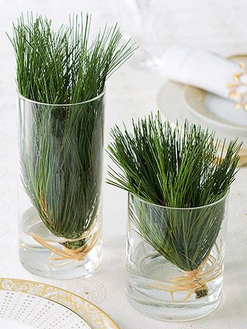 Quick Thinking  --  Need a last-minute table decoration? Snip greenery from your tree and bind the ends together with raffia bows, then place inside clear glasses filled with an inch of water. Smells Heavenly too!!