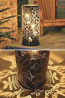 punched metal lantern - so pretty on a patio