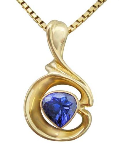 18k yellow gold pendant with Tanzanite by Hanna Cook-Wallace.