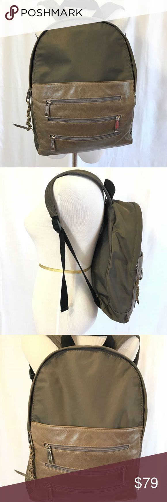 """Rebecca Minkoff Khaki Leather Backpack This backpack is for the woman with """"stuff"""" to tote!In a beautiful neutral Khaki that works with everything, It has wonderfully padded shoulder straps, a big storage area for larger items, interior zip pocket and also exterior zip pockets plus one large slip pocket. Yet, it's leather front and braided tassel gives it an edgey silhouette. 17""""x13""""x4 Best of all there is not not another like it to be found! Please no insulting offers or trade requests…"""
