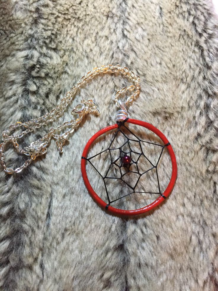 Hand wrapped, woven and painted red dreamcatcher pendant with burgundy dark red glass pearl and 18' nickel free chain by EarthDiverCreations on Etsy https://www.etsy.com/ca/listing/496798665/hand-wrapped-woven-and-painted-red
