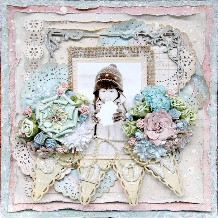 Scrapbook page using doilies and banners as dimension on the page