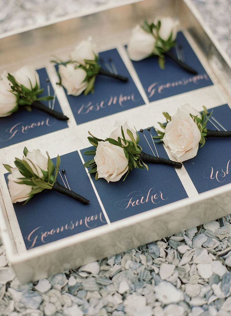 peach and navy blue charleston inspired wedding at wild dunes resort in charleston south carolina white rose boutonnierenavy