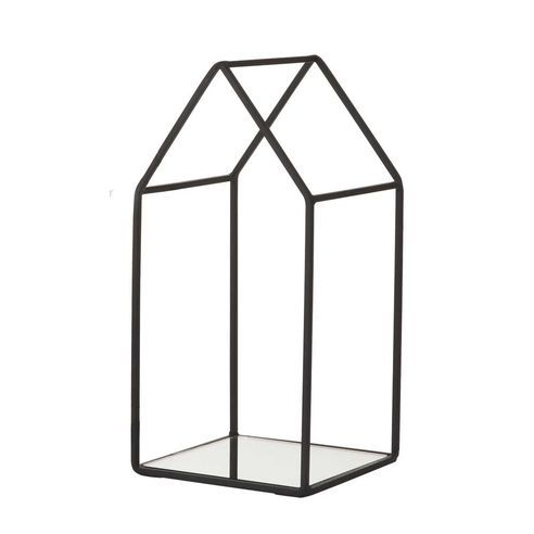 Bahne House Votive Candle Holder: This House Votive in Black from Bahne is a pretty candle holder with a mirrored base that beautifully reflects the flickering candle light.