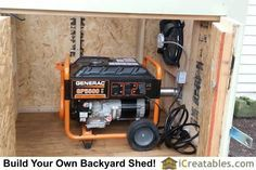 Generator installed in generator enclosure.Powered gable vent installed above hookup for exhaust port. Vent turns on when generator is powered.
