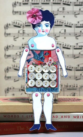 Doll arms and legs attached to a vintage button card.