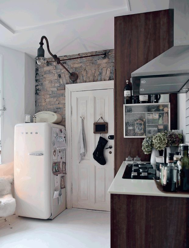 Kitchen with white SMEG fridge.