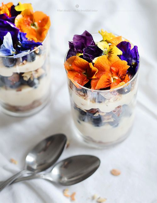 an elegant breakfast; granola with lemon yogurt and edible flowers (what should I eat for breakfast today makes me wish I were more organised in the morning - brilliant recipes and photography)