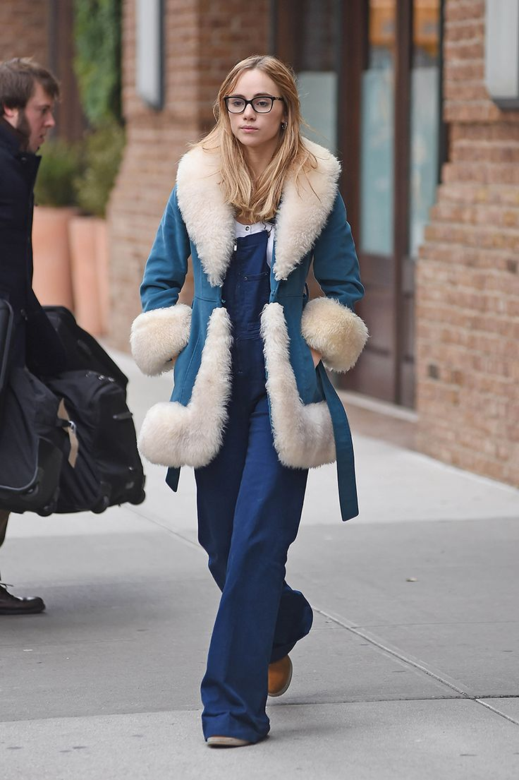 Model and actress Suki Waterhouse sported a robe-like version with fuzzy cuffs, collar, and hem trim for a cozy-chic approach to the chilly temperatures.