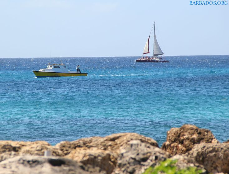 Traditional fishing boat and modern catamaran share the seas around Barbados