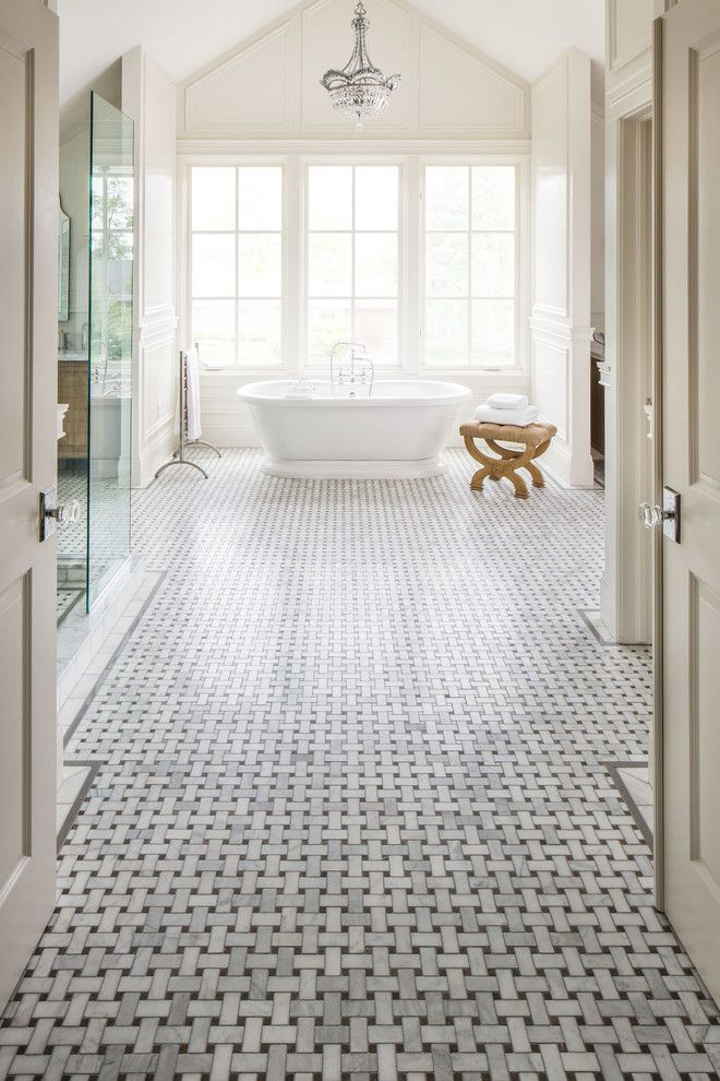 this bathroom used white marble mosaic with basket weave design on the floor and it looks