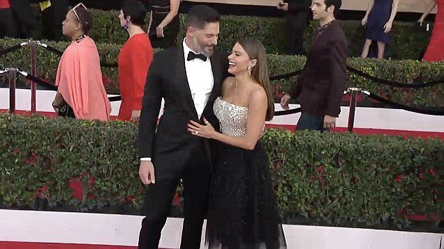 Joe Manganiello makes wife Sofia Vergara laugh on the Screen Actors Guild Awards  red carpet. Sofia stunned in a silver and black 'ballerina' inspired dress.