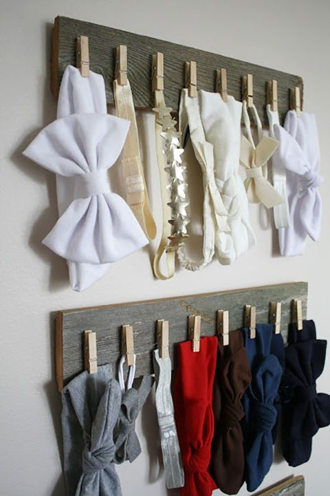 Try mounting items or accessories you'll use regularly—this blogger used wood from an old projectand clothespins to hangall of her daughter's headbands for a simple, rustic display. Get the tutorial at Live A Little Wilder.
