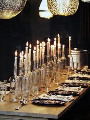 Wine Bottles as Candle Holders - love the drama of this table. wine drinkers - save your bottles !