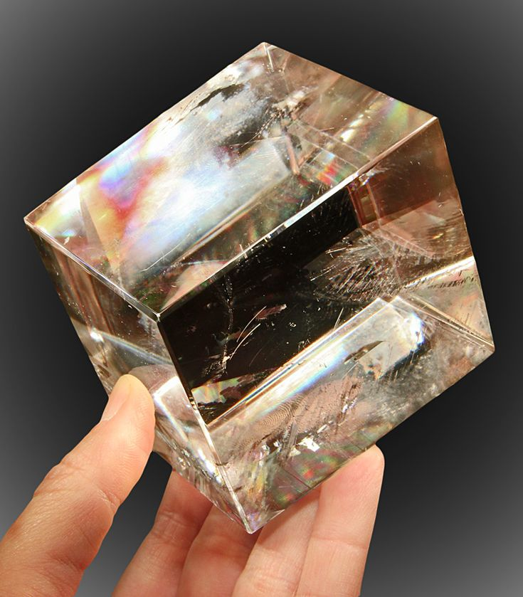 Iceland spar is a clear, transparent, colorless crystallized variety of calcite (calcium carbonate, CaCO3). Large pieces are split along natural cleavage planes to form natural rhombs. Iceland spar is probably best known for exhibiting the optical property of double refraction - so, anything viewed through the crystal appears double.