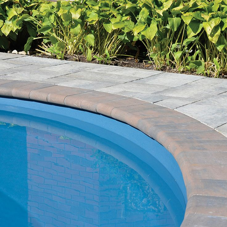 Poolside landscape. Project application using Cassina pavers. Color: Cassina Timberwood by Oaks Landscape Products.