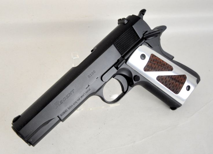 """Umarex Regent R100 1911 with Hogue Extreme Grips .45 ACP. Umarex #2247000. The R100 from Regent is a full-size semi-automatic 1911 pistol. It features a classic 1911 design, plus a slide manufactured from CNC machined bar stock, low-cut ejection port, steel investment cast frame, hammer forged stainless steel barrel. Accepts virtually all aftermarket 1911 parts, allowing for simple customization. Two grip sets included. 7-round capacity of .45 acp. 5"""" barrel. 40 oz. [New in Box] $529.99"""