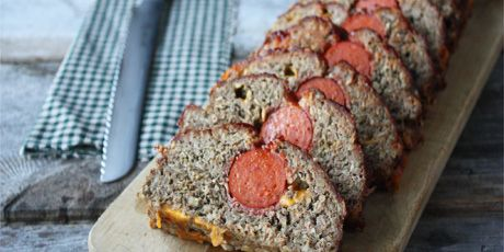 Pepperoni Cheddar Meatloaf - A baked, beefy meatloaf with a pepperoni sausage in the middle and topped with a homemade glaze. This recipe also features a number of suggested variations and twists