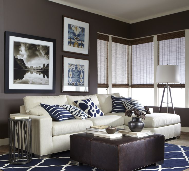 Accentuate The Eclectic With An Artful Mix Of Pillows Artwork And Accents