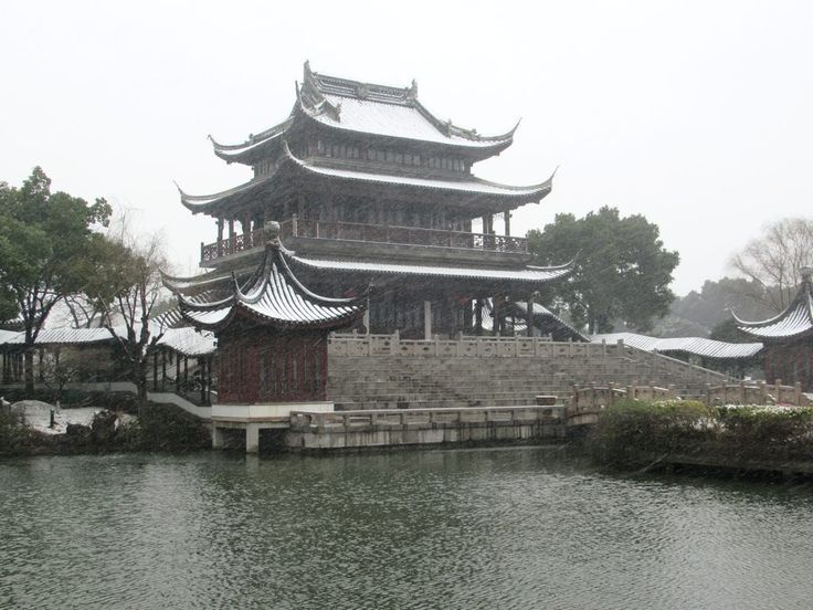 The three-story Hall of Attractive Scenery in the Panmen Scenic Area at Suzhou, China, offers views across a small lake.