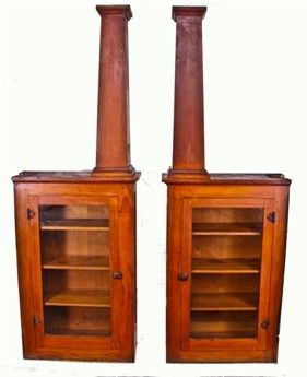 """c. 1905-10 interior residential craftsman bookcase cabinets with tapered square columns. the room divider is made of solid white oak wood with original stained finish. each cabinet contains wood shelves with bracket hardware. the front and back side of each cabinet is finished (the latter having a large recessed panel). the molding and/or trim work is completely intact. the cabinets measure 29 1/4"""" x 12 1/2"""" x 46 1/4"""". the overall height is 84 inches."""