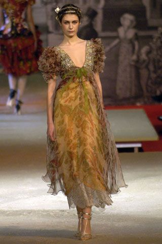 Christian Lacroix Spring/Summer 2006 Couture.....Very rich in color and love the shoulder design.   B.
