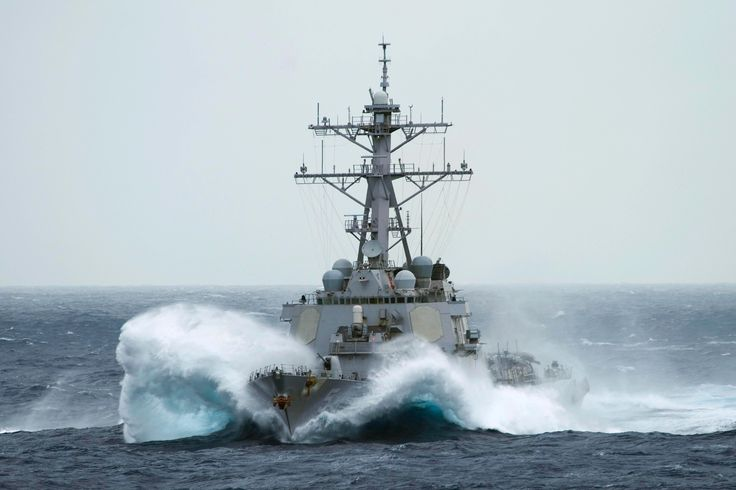 The guided-missile destroyer USS Curtis Wilbur (DDG54) transits through rough seas in the Pacific Ocean