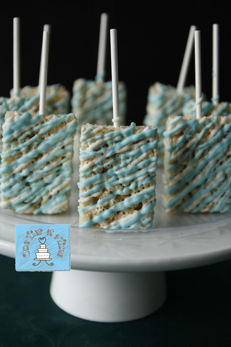 Frozen themed chocolate covered rice krispie treats. - Frozen dessert table - blue and white chocolate