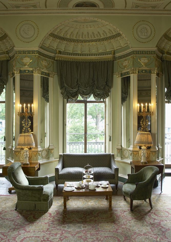 """neo-classical Drawing Room, Featured in the 'Home House"""" designed by Robert Adam, 1777. featuring mirrors, table, armchairs and sculptural designs."""