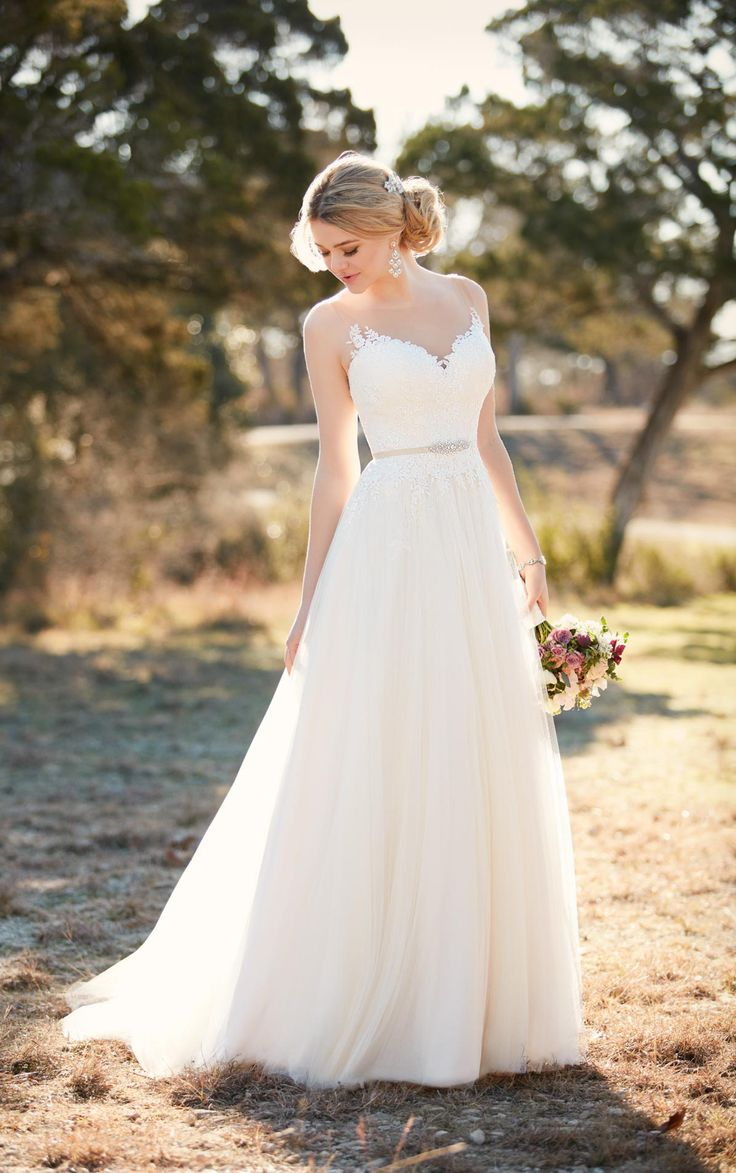 """This A-line wedding dress from Essense of Australia features an illusion lace bodice with glistening Diamante accents. The French tulle skirt falls gracefully to the floor into a romantic court train. The back zips up with ease under sparkling crystal buttons. Accent your waist with a 1/2"""" beaded grosgrain belt."""