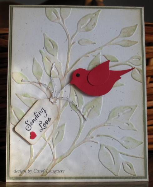 handmade card ... Sending Love by carol_PA925 -  ... challenge card with lovebird theme .. embossing folder branches lightly inked on highlights ... red two-step bird punch ... small tag with the sentiment ... sweet card ....