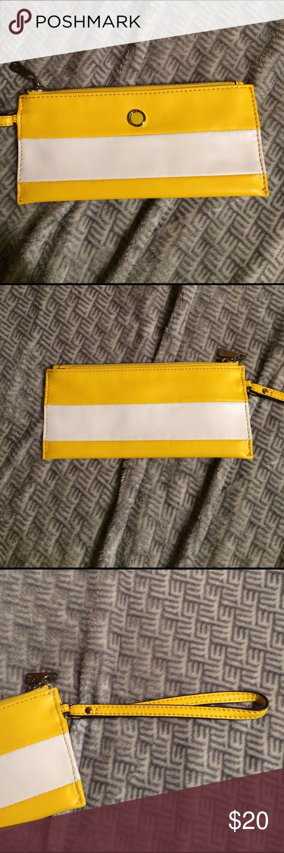 Grace Adele wristlet NWOT Yellow and white Grace Adele wristlet. Never used and have been kept in the dust bag it came in. Super cute just not my style. Grace Adele Bags Clutches & Wristlets