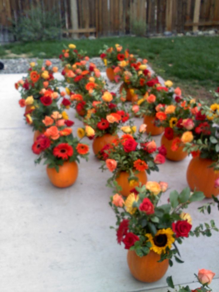 Table Centerpieces for fall wedding arranged in pumpkins.
