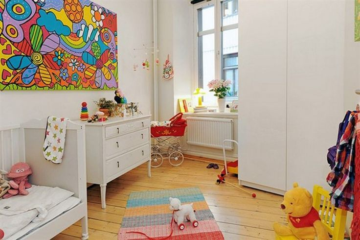 Red Baby Stroller And WHite Cabinet And Wooden Floor Of Kids Playroom
