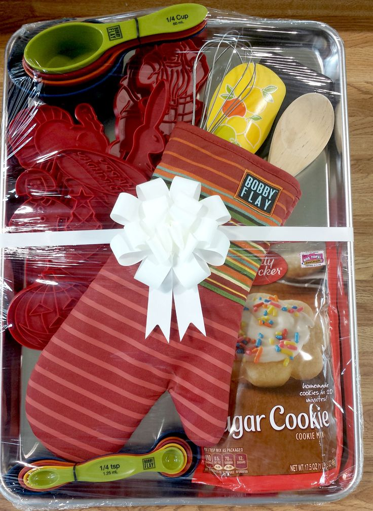 Great gift idea for a bridal shower or silent auction item for a fundraiser.  So easy to assemble with a cookie sheet, oven mit, baking utensils, cookie mix and I used some vintage cookie cutters.