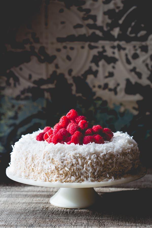 Coconut Raspberry Greek Yogurt Layer Cake by Healthy Seasonal Recipes is made with fresh raspberries, coconut sugar and fat free Greek yogurt to make it healthier.