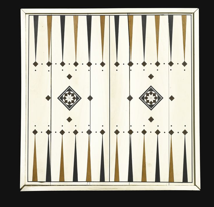 A rare Nasrid ivory and wood inlaid gaming board, Spain, 14th-15th century | lot | Sotheby's; 41.6 by 40.7cm; composed of ivory, designed as a backgammon board on one side, with ebony and light wood alternating points and geometric stellar motifs in centre, the other side designed as a chess board