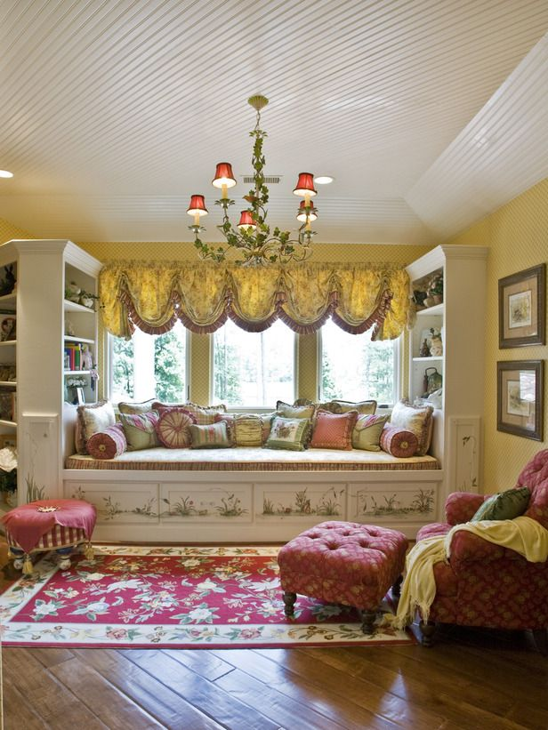Gorgeous valance and a decadent selection of pillows on this inviting window seat.