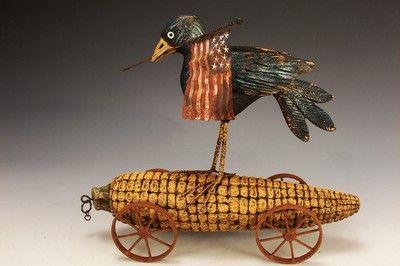 Google Image Result for http://www.peterbretzcarvings.com/gallery/bb_folkart_corn_on_wheels.jpg