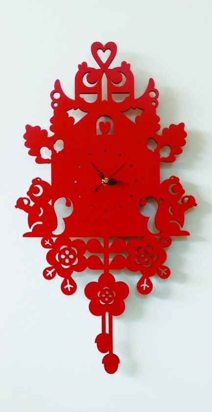 Swedish children's cuckoo clock -- all surfaces, the face and folk decorative surround, are finished in primary red www.bluebirdandhoney.com