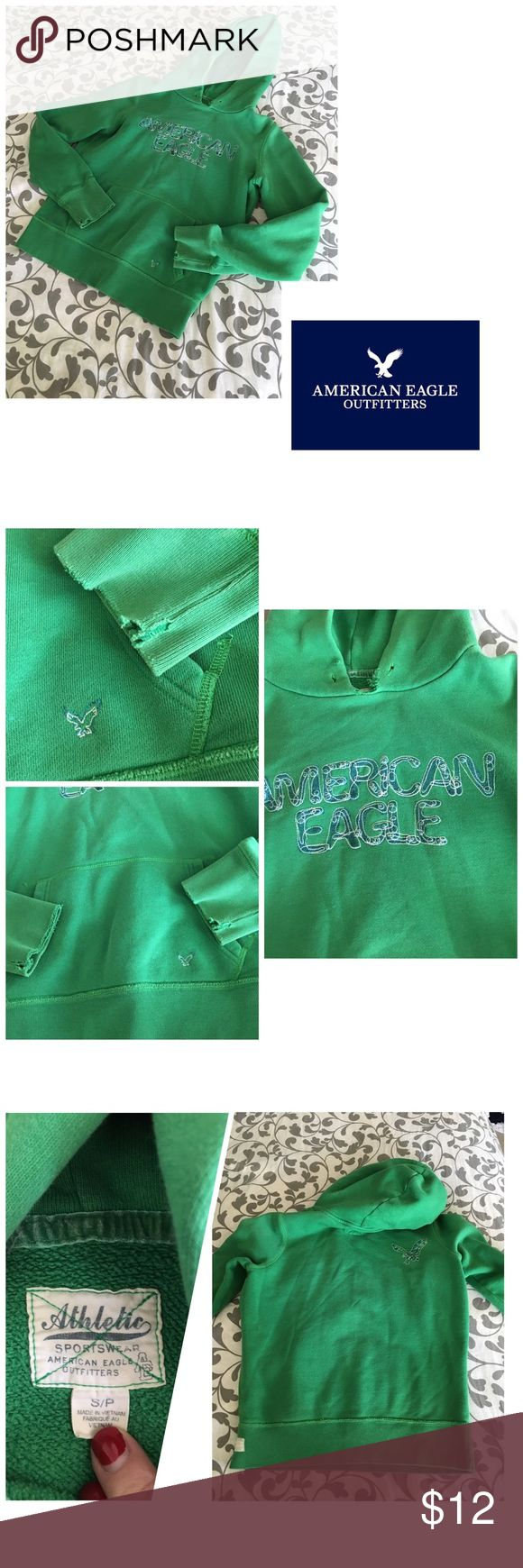American Eagle green pullover hoodie Well loved, distressed everywhere. Please see all pictures. PLEASE, REASONABLE OFFERS ONLY!  -Smoke and pet free - If its $10 or under, I WILL NOT accept offers. -I do not model anything; everything looks different on everyone and I don't wasn't too Jade that. I will put the item on a dress form or find factory pics and provide measurements. -NO HOLDS, NO TRADES, POSH RULES ONLY! American Eagle Outfitters Tops Sweatshirts & Hoodies