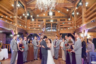 """The reception was in a gorgeous barn with a staircase leading into the center of the room, and it was only a mile away from the ocean,"" Chonel said.    Reception Venue/Caterer: Red Lion Inn Resort   Floral Designer: Stow..."