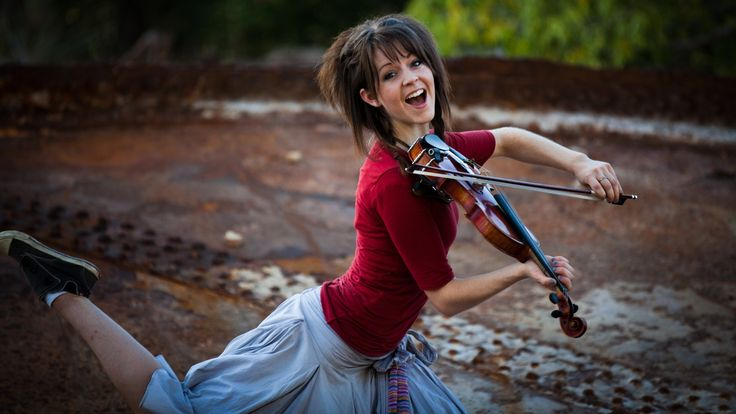 """Lindsey Stirling, the hip-hop violinist appeared at the Washington D.C. Visitors' Center on 25 June 2014 sharing her faith and playing her violin."""" Description from pinterest.com. I searched for this on bing.com/images"""