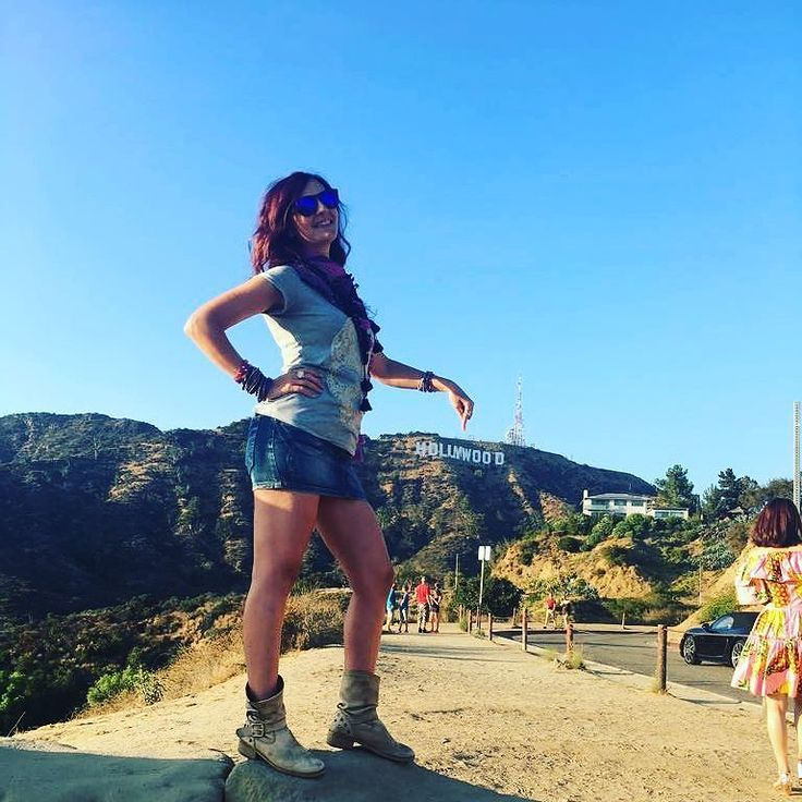 Perspective games!  Unfortunately I didn't have the chance to get closer to the sign. . . . . #hollywood #Hollywoodstar #hollywoodsign #Billboard #billboards #Hills #hollywoodhills #california #losangeles #USA #ontheroad #lenonthemove #travel #tourism #tourist #skirt #miniskirt #style #travelphotography #travelblogger #legs #boots