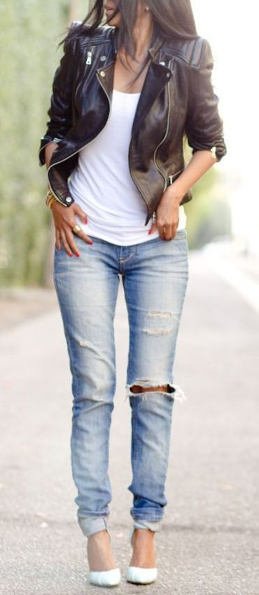 Choose a black leather moto jacket and light blue distressed skinny jeans for a glam and trendy getup. A cool pair of white leather pumps is an easy way to upgrade your look. Shop this look for $72:lookastic.com/... — Black Leather Biker Jacket — White Tank — Gold Statement Bracelet — Light Blue Ripped Skinny Jeans — White Leather Pumps