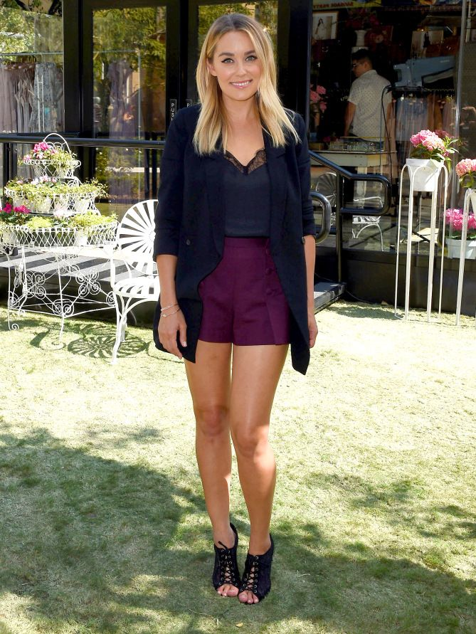 LAUREN CONRAD | People Style Watch | #lclaurenconrad #laurenconrad in burgundy shorts and a long blazer at her LC Lauren Conrad Runway Pop-Up Shop in Glendale, California.