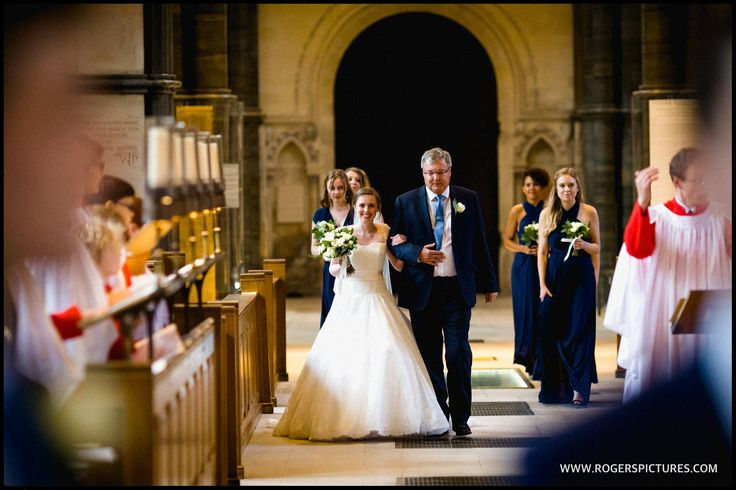 Lauren and her Dad walking down the very long aisle at Temple Church in London -