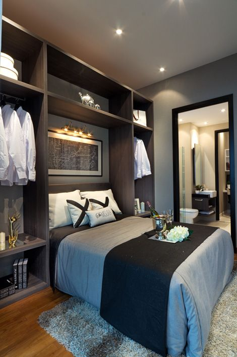 small bedroom space with great storage lighting above bed is great