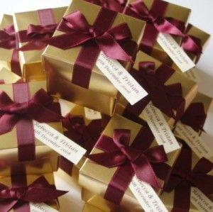 Burgundy and Gold Ides  http://www.google.com/imgres?q=burgundy+and+gold+wedding&um=1&hl=en&client=safari&tbo=d&tbm=isch&tbnid=4Hyr2rI-cbqJIM:&imgrefurl=http://www.bestboer.com/206-personalised-wedding-favour-boxes.html&docid=aTbs7awOgkCqlM&w=300&h=299&ei=_AWATpbfL8-htwetq4HXCQ&zoom=1&biw=768&bih=916